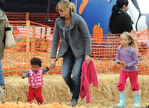 Heidi and her daughters Lou and Leni love their annual trip to the pumpkin patch. - Giovanni/Splash News