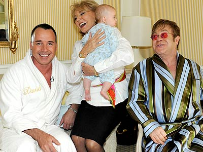 David Furnish and Elton John with Barbara Walters and baby Zachary. - ABC/Donna Svennevik