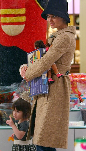 Katie Holmes and her daughter Suri load up on goodies for children in need at the FAO Schwarz store in NYC. - Jackson Lee/Splash News