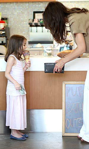 Little Suri couldn't wait to dig in to her chocolate, sprinkle-covered waffle cone! - Pichichi/Splash News