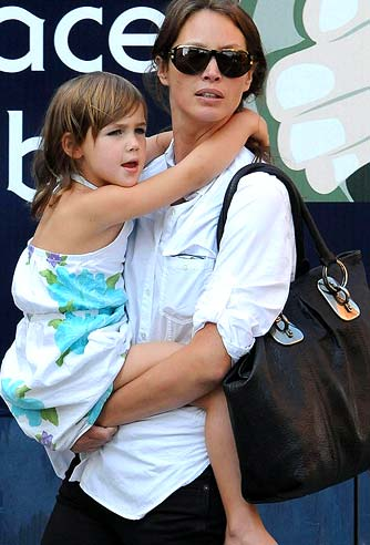Christy Turlington carries her daughter Grace around NYC. - Hector Vallenilla/PacificCoastNews.com