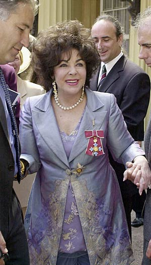 Dame Elizabeth Taylor leaves Buckingham Palace after receiving the honour of Dame Commander of the Order of the British Empire from Queen Elizabeth II, May 16, 2000. - Anwar Hussein/Getty Images