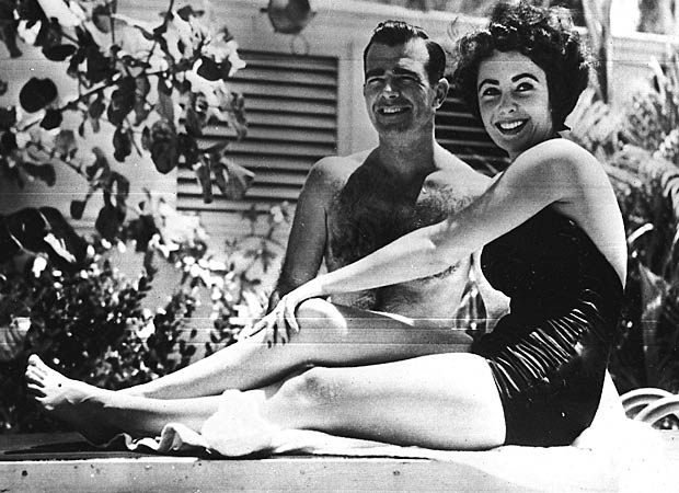 A 17-year-old Elizabeth Taylor poses with fiance William D. Pawley Jr. in June 1949. - AP Photo