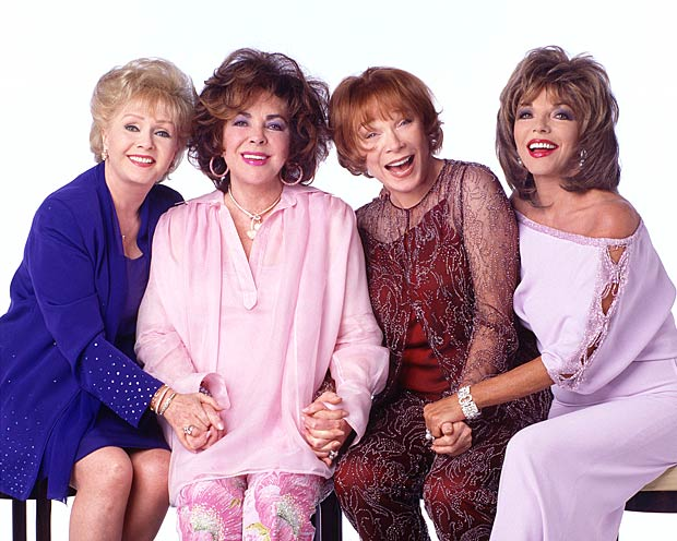"Taylor poses for a cast shot with her ""These Old Broads"" co-stars, Debbie Reynolds, Shirley MacLaine, and Joan Collins. The 2001 TV movie was her final onscreen role. - Everett Collection"