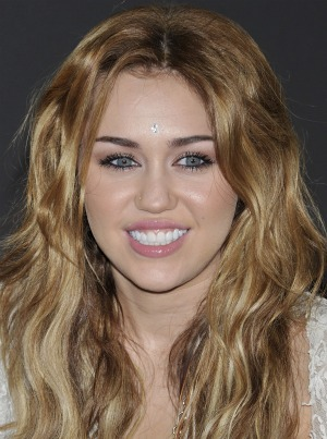 Miley smiles as the big 1-8 approaches. - Carlos Alvarez/Getty Images
