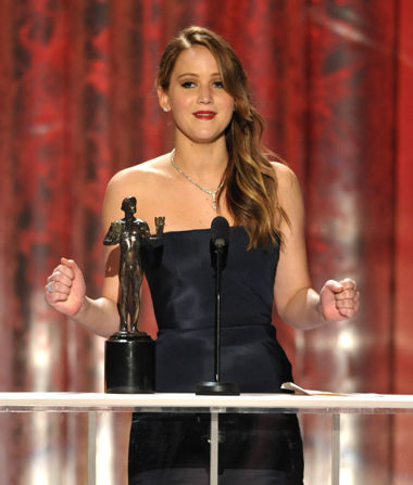 Jennifer Lawrence accepts her first SAG Award on Sunday (Photo: John Shearer/Invision/AP)