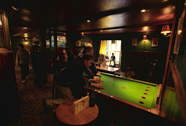 People playing bar billliards at the Moulin Inn, Pitlochry, Perthshire, Scotland (Photo by Gary Latham/Visit Britain)