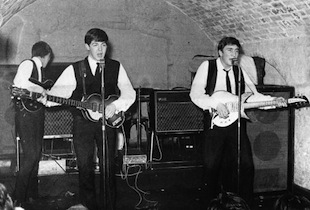 George Harrison, Paul McCartney and John Lennon of The Beatles performed at the Cavern Club on August 22, 1962. (Photo by Michael Ochs Archives/Getty Images)