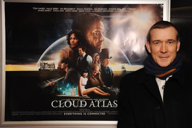 David Mitchell poses with the poster for the movie adaptation of his book 'Cloud Atlas.' The versatile author also writes operas. (Photo by Dave J Hogan/Getty Images)
