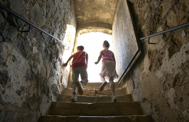 Children explore Dover Castle. The clifftop fortress boasts more than 2,000 years of commanding the English Channel on the coast of England and could be the site of a post-apocalyptic bunker. (Photo by Daniel Bosworth/Visit Britain and Kent Tourism Alliance)