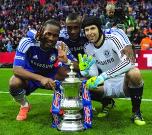 Didier Drogba, Salomon Kalou and Petr Cech of Chelsea celebrate with the trophy after the FA Cup Final match between Liverpool and Chelsea at Wembley Stadium last May. (Photo by Shaun Botterill/Getty Images)