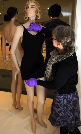 Rosemary Harden makes last adjustments to a mannequin wearing a knitted 1930s swimsuit for an exhibition at the Fashion Museum in Bath. (Photo by Matt Cardy/Getty Images)