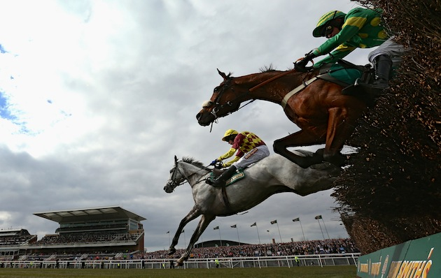 Dynaste ridden by Tom Scudamore clears the last fence alongside Third Intention ridden by Joe Tizzard on their way to victory in The John Smith's Mildmay Novices' Steeple Chase on April 5 at Aintree Racecourse. (Photo by Alex Livesey/Getty Images)