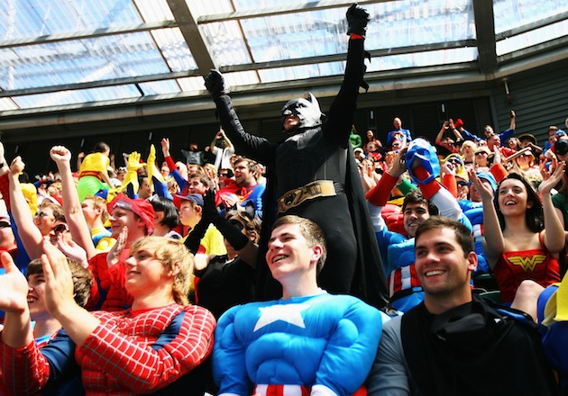 Fans celebrate breaking the Guinness World Record for the most people dressed as superheroes during a 2010 rugby match at Twickenham Stadium in London. (Photo by Mark Wieland/Getty Images)