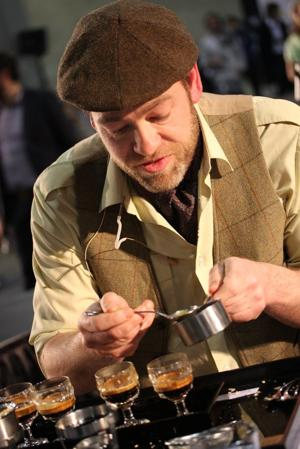 Gwilym Davies composing his signature drink at the 2009 World Barista Championship in Atlanta, Georgia. (Photo by Liz Clayton via Wikimedia Commons)