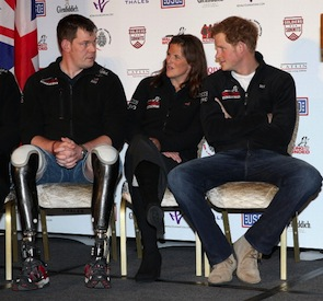 Prince Harry chatted with Duncan Slater (L) and Kate Philip (C) at the launch for the Walking with the Wounded South Pole Allied Expedition. (Photo by Chris Jackson/Getty Images)