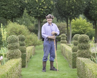 A gardener stands proudly in the gardens of Hatfield House. (Photo by Rod Edwards/Visit Britain)