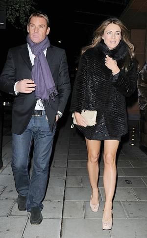 Liz Hurley and Shane Warne were spotted dining at C London Restaurant. (Photo by Sylvia Linares/FilmMagic)