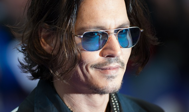 Genealogical research shows that Johnny Depp may be related to Queen Elizabeth II. (Photo by Ian Gavan/Getty Images)