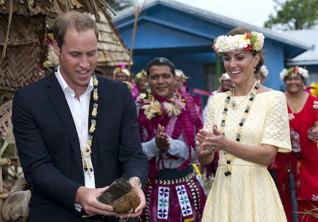 Prince William opened a coconut with a machete as Kate looked on during their trip to the Pacific island of Tuvalu on a Diamond Jubilee tour in September. (Photo by Arthur Edwards - Pool/Getty Images)