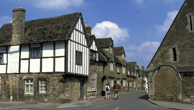 Lacock's East Street, with the 14th century Tithe Barn at right. (Britain on View/Visit Britain)