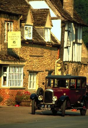 A vintage car in Lacock Village, England. (Photo by Britain on View/Visit Britain)