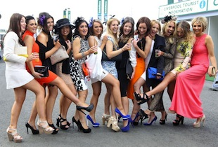 Racegoers enjoy Ladies Day at Aintree in Liverpool, England. Friday is traditionally Ladies day at the three-day meeting of the world famous Grand National, where fashion (from fabulous to just fun) is as important as the racing (Photo by Danny E. Martindale/Getty Images)