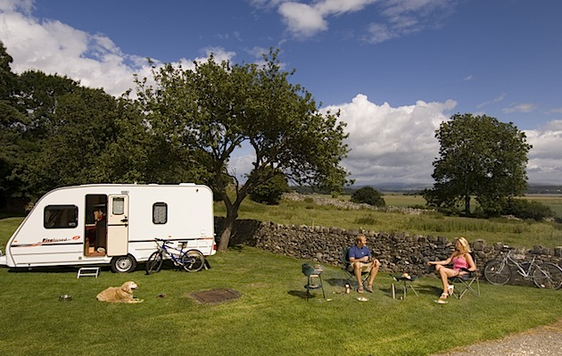 A couple relaxes at the Meathop Fell Caravan Site in England's Lake District. (Photo by Rod Edwards/Visit Britain)