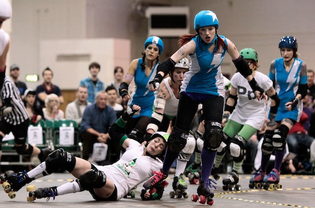 The Suffra Jets (blue) compete with the Ultraviolent Femmes (white) during a London Rollergirls Roller Derby event. (Photo by Matthew Lloyd/Getty Images)