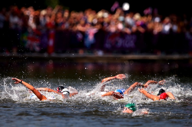 Top: Swimmers compete in the Women's 10K open-water swim at the Serpentine in London's Hyde Park. (Photo by Ryan Pierse/Getty Images)