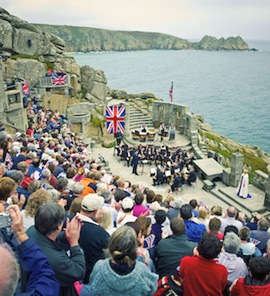 A daytime audience hears music at The Minack Theatre in Cornwall, England. (Photo by Britain on View/Visit Britain)