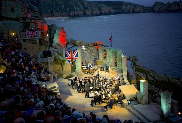 Musical acts and plays take the cliffside Minack Theatre stage at night. (Photo by Britain on View/Visit Britain)