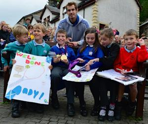 Andy Murray returned to Dunblane, Scotland, following his win in the US Open and his gold medal in the 2012 Olympic games in London. Thousands lined the streets of his hometown as the 25-year-old returned to meet with family and friends following his summer triumphs. (Photo by Jeff J Mitchell/Getty Images)