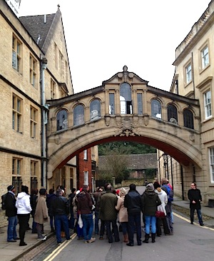 A tour group takes in the Bridge of Sighs over Queen's Lane in Oxford. (Photo by Amelia Gurley)