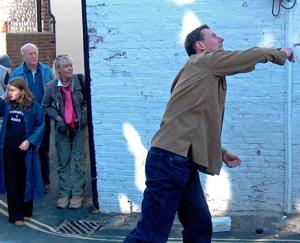 Mark Harris takes a throw as the Lewes Arms pub hosts its annual World Pea Throwing Championship (Photo by Monty Watkins)