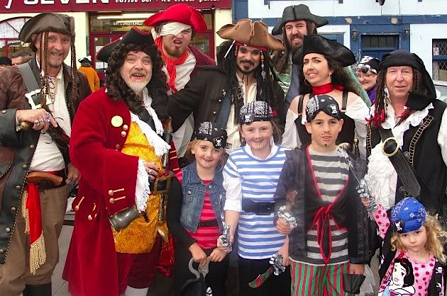 Pirates of all ages meet at Brixham for the town's waterfront Pirate Festival. (Photo courtesy Brixham Pirate Festival)