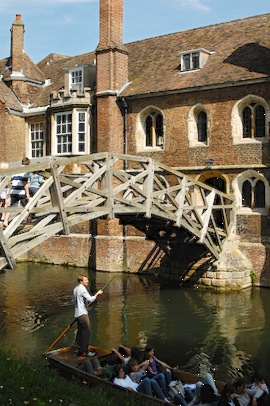 Punters pass the famous Mathematical Bridge and Queen's College at the University of Cambridge. Cambridge is famous for both mathematics and punting. (Photo by Britain on View/Visit Britain)