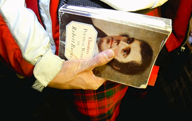 On Burns Night, Scots across the world celebrate the life of Robert Burns, the country's most famous bard, by reciting his poetry, eating haggis and imbibing whisky. (Photo by Graeme Robertson/Getty Images)