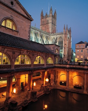 The Great Bath of the Roman Baths, shown here at night, is part of a World Heritage site at Bath, England. (Photo by David Angel/Visit Britain)