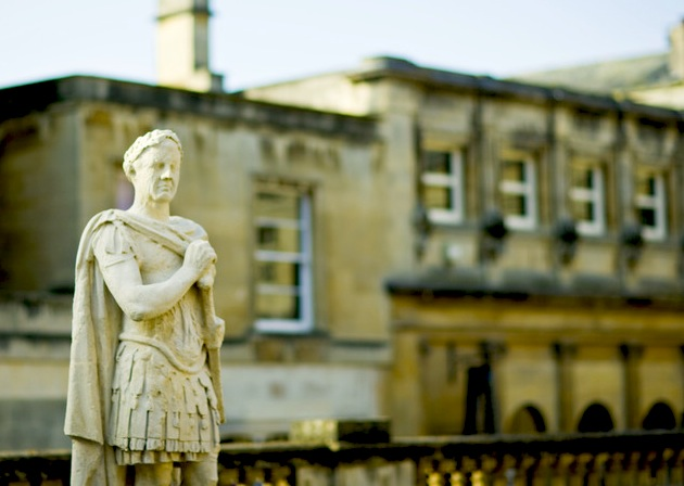 A statue stands sentinel outside the Roman Baths, a World Heritage site, at Bath, England. (Photo by Simon Winnall/Visit Britain)