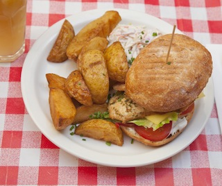 This sandwich is served on a bap with hand-cut chips at the Breakfast Club diner in Islington. (Photo by Pawel Libera/Visit Britain via Visit London)