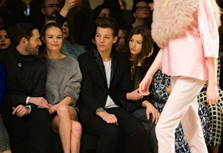The fun goes beyond music: Louis Tomlinson (with Michael Polish, Kate Bosworth, and Eleanor Calder) recently attended the Topshop Unique show during London Fashion Week. (Photo by Samir Hussein/Getty Images)
