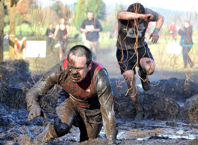 Tough Mudder endurance challenges in the UK, like this one at Cholmondeley Castle last year, raise funds for Help for Heroes. (Photo by Shirlaine Forrest/Getty Images)