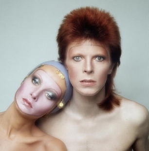 David Bowie is known for stylized and often androgynous looks. Here he poses with English model Twiggy for the cover of his 'Pin Ups' album in 1973. (Photo by Justin de Villeneuve/Hulton Archive/Getty Images)