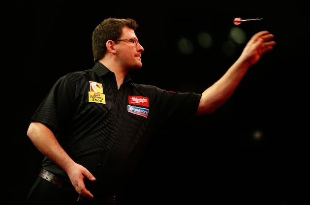 James Wade of England throws a dart during this year's Ladbrokes.com World Darts Championship at Alexandra Palace in London. (Photo by Paul Gilham/Getty Images)