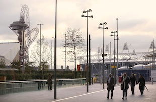 Shoppers walk past the London 2012 Olympic Park at the Westfield Stratford City Shopping center. (Photo by Oli Scarff/Getty Images)
