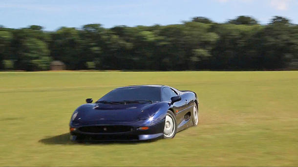 Watch a Jaguar XJ220 power slide through the British countryside