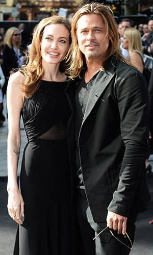 Angelina Jolie & Brad Pitt, photo courtesy of Getty Images.