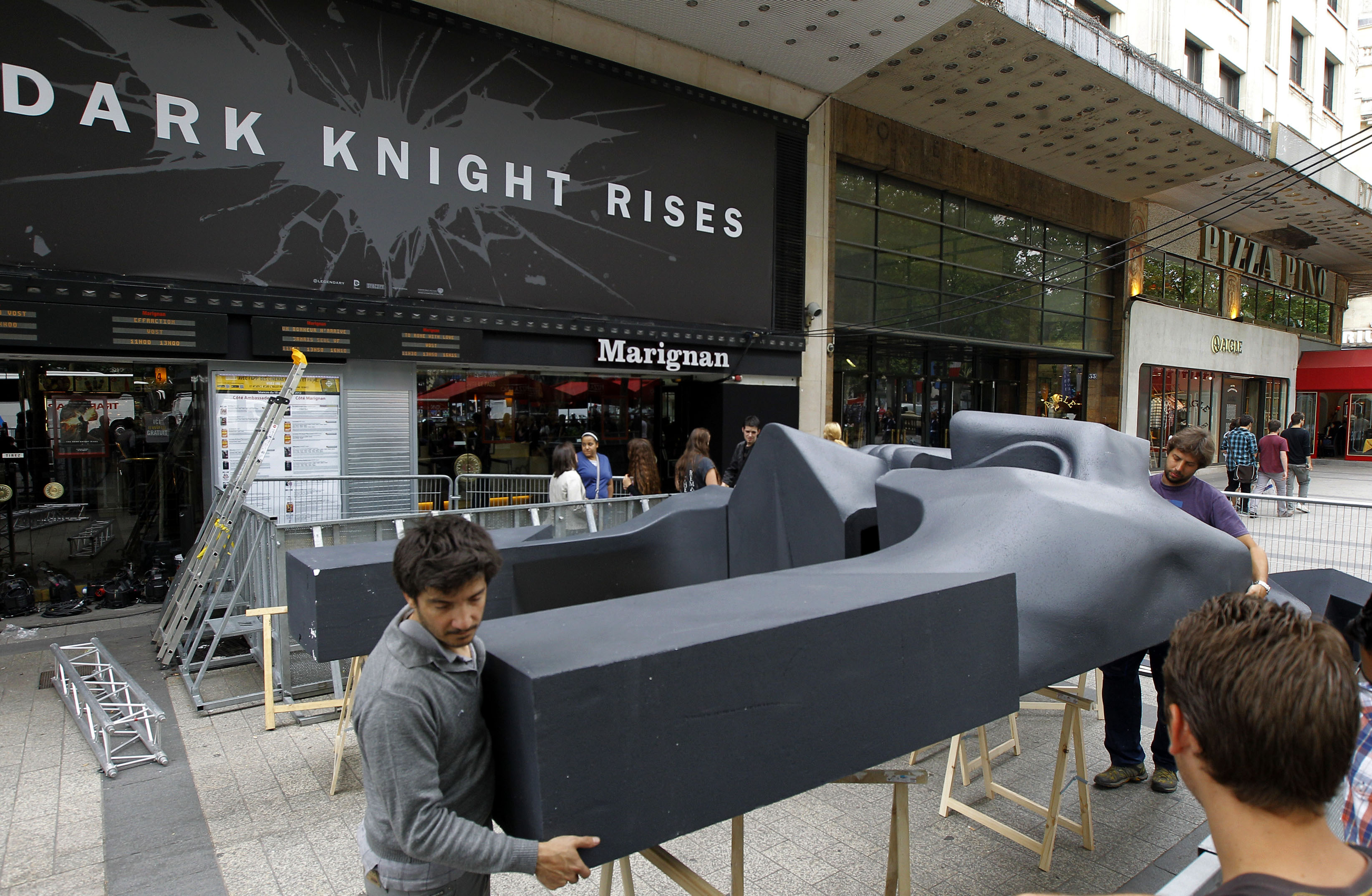 "Workers dismantle a ""TDKR"" installation in Paris on Friday (Photo: AP Photo/Jacques Brinon)"