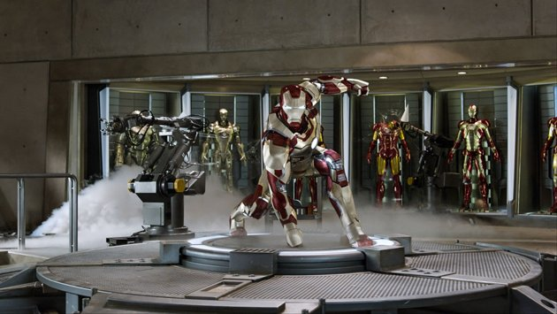 Robert Downey Jr. suited up in front of the Hall of Armor in Marvel Studios' 'Iron Man 3'